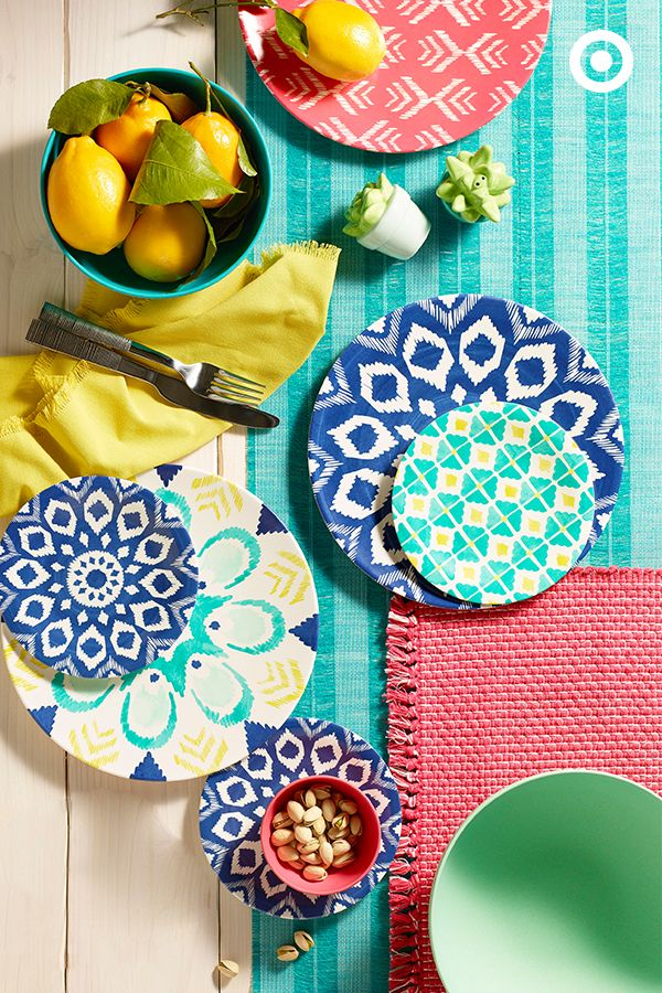 Set a summer table on a budget. Bring natural energy to your spread with a mix of contrasting colors and patterns. From dinner for two to dinner for ten, with just placemats, melamine plates, and a bright table runner, you've got the makings of a pretty perfect meal.