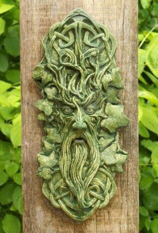 Looks a bit like Donald Sutherland, but brings his green through the ivy instead of oak. Lots of hard wood showing, indicating the crystallization of matter - this energy is not as supple as the young vine. The infinite Celtic knots symbolize the turning of the infinite spiral of time. And this particular guy has seen many seasons.