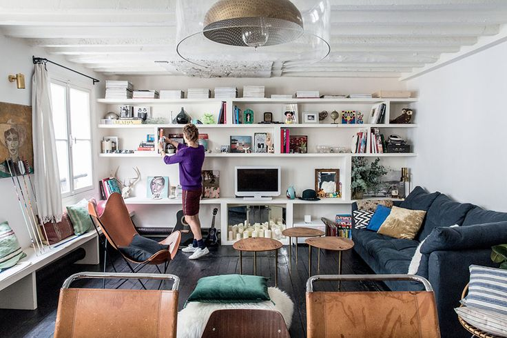 This is the home ofAnne-Fleur Broudehoux and her partner Thierry Lebraly, who live in the10th arrondissement of Paris. I'm really jealous of peoplewhose homes are architecturally as interesting and quirky as this - decorating them must be so fun. In this particular building the rooms are