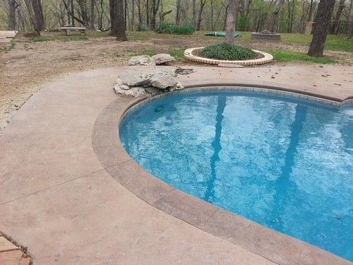 Pool Decking Ideas Concrete stained concrete foundations pool deck lace micro toppings Stamped Concrete Pool Decks Photos Stamped Concrete Pool Deck Coping Old Granite New Diving Rocks For The Home Pinterest Concrete Pool And