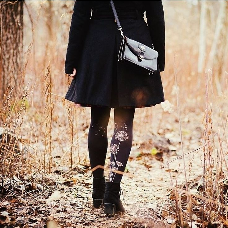 Klara @arobotheart wearing our dandelion print at the back of her legs.  Our S-L sized tights have no front or back, so you can deceide how to wear them.