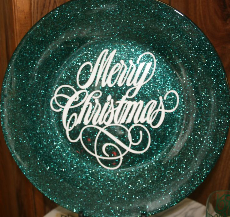 Shiny glittery green glass charger plate.  Merry Christmas in white vinyl.  $20.  Pier One Charger.  www.facebook.com/plainjanecreations