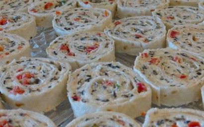 Cream Cheese Ranch Rollups 2 packages (8 Oz. Size) Cream Cheese, Softened 1 package (about 1 Oz. Packet) Ranch Dressing Mix ½ cups Finely Chopped Red Pepper ½ cups Finely Chopped Green Onions 1 can (2.25 Oz. Size) Chopped Black Olives 4 whole 12 Inch Flour Tortillas combine all in bowl, spread on tortilla, roll up,put in plastic wrap & refrigerate overnight then slice!