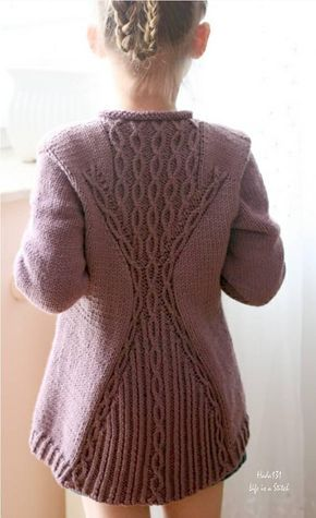 """""""Cabletta Junior"""" is a beautiful garment with an interesting hourglass shape on the back inspired by a store bought sweater.This cardigan is knit top down, completely seamlessly with set in sleeves worked using short rows. First, you knit the back and then both fronts. When you reach the underarms, join all pieces to work them together. Once you complete the body, pick up the stitches around the armholes to work the sleeves from the top down."""