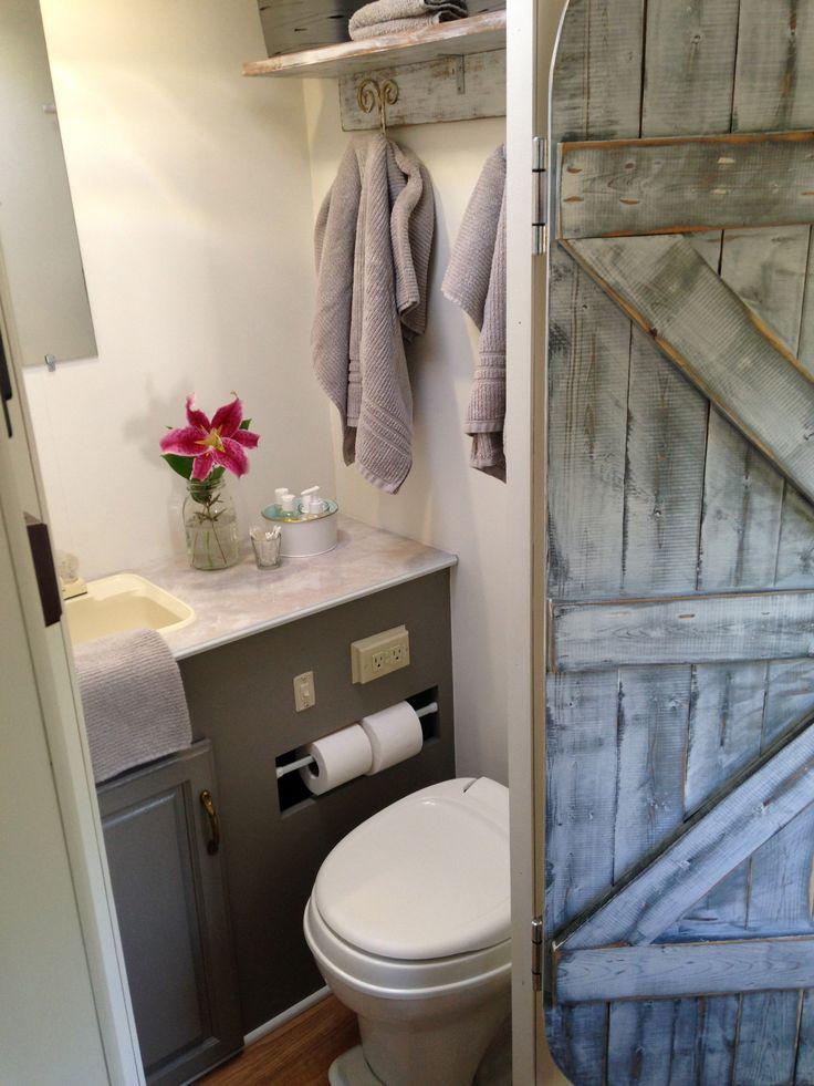 Pine tree home camper redo small bathroom barn door for Redoing bathroom walls