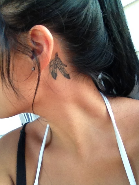 Feather tattoo behind my ear.