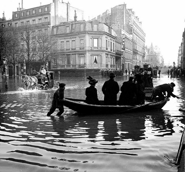 Avenue Montaigne, Paris, France, 1910 | Flickr - Flood of the century, yet ladies still need to shop!