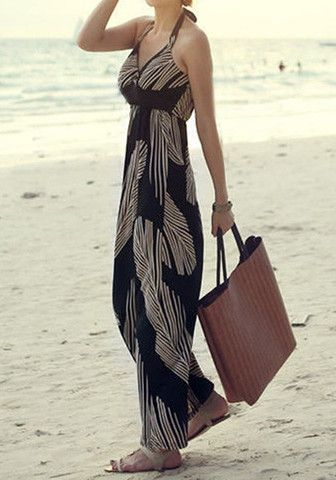 Model wearing feather print maxi dress and tote bag at the beach