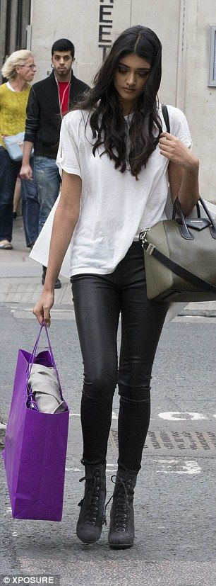 Neelam Gill looks lithe in leather trousers and a basic white T-shirt #dailymail