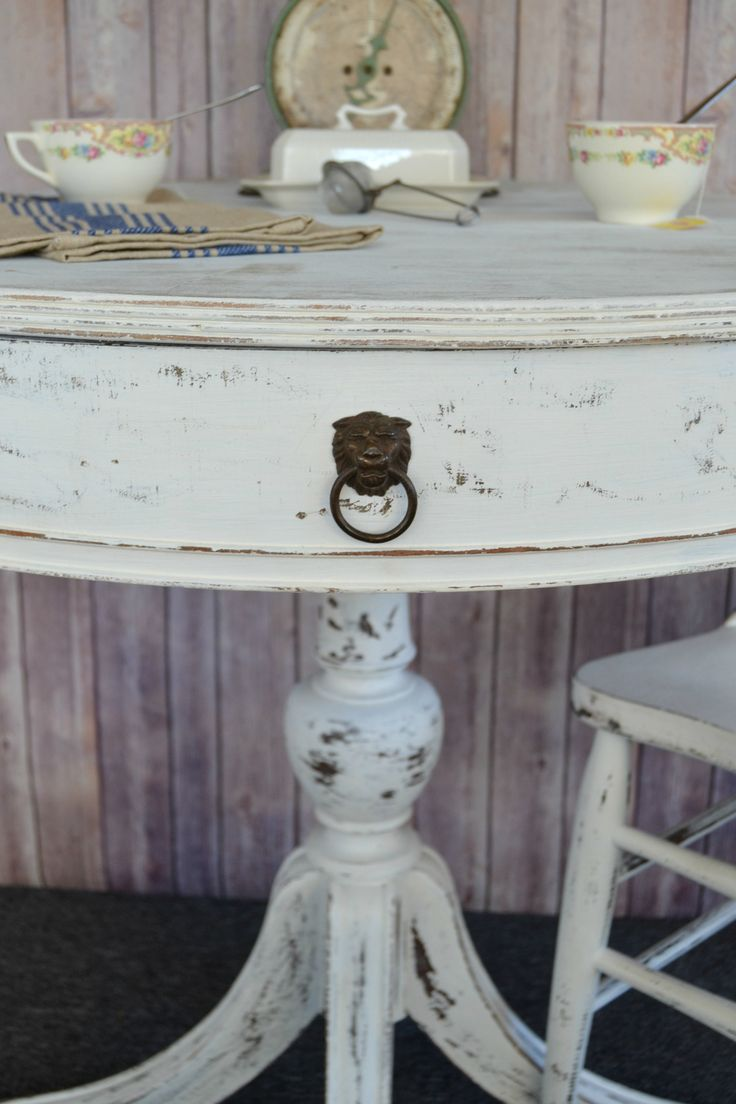 Do you like white decor? Check out this how I made this dilapidated table a beautiful white, round table with paint and sandpaper.