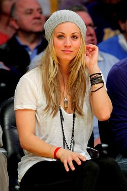 "Kaley Cuoco-- outfit-a simple ""dirtywhite"" tee,a pair of simple black jeans (or maybe sweats?) and a knit cap. The girl's got style. :)"