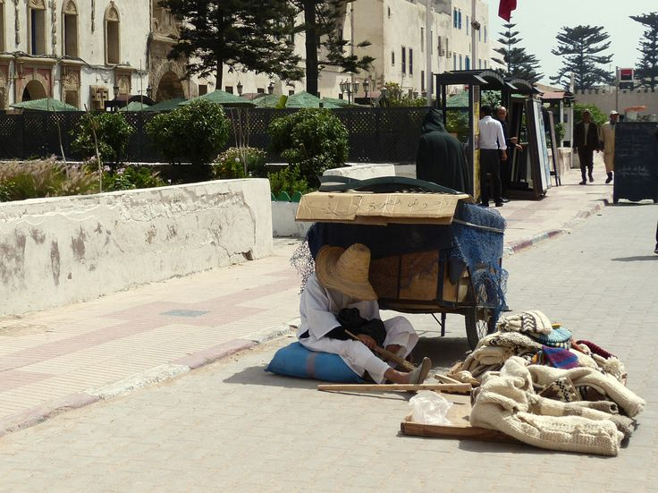 Man sleeping under a cart in Essaouira