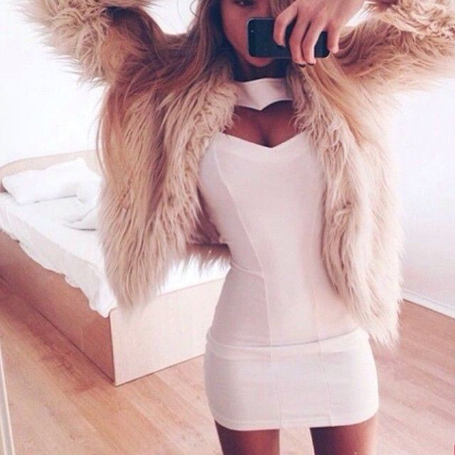 love this! white cutout dress with a fur coat