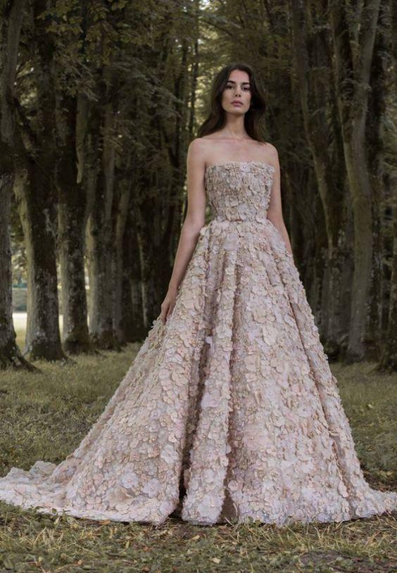 Stunning strapless beige flower wedding dress; Featured Dress: Paolo Sebastian