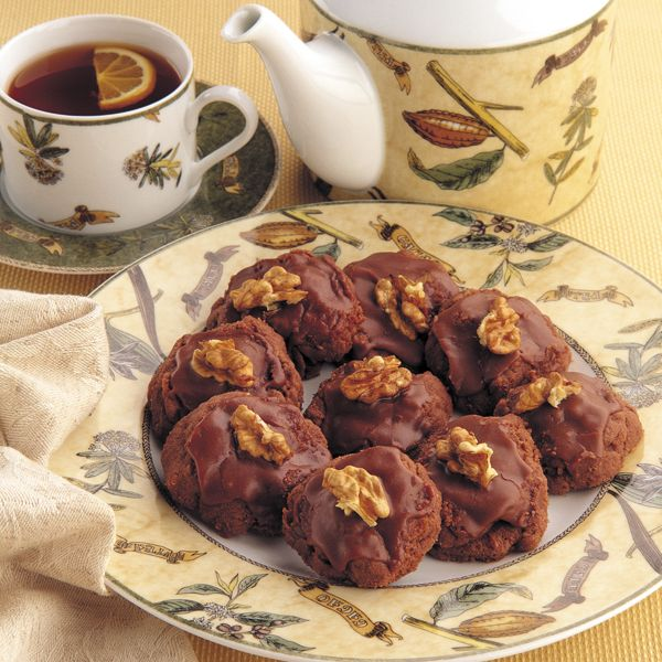 Edmonds Cooking New Zealand | Afghans 200g butter, softened ½ cup sugar 1¼ cups Edmonds standard flour ¼ cup cocoa 2 cups cornflakes Chocolate Icing 24 walnuts (optional)