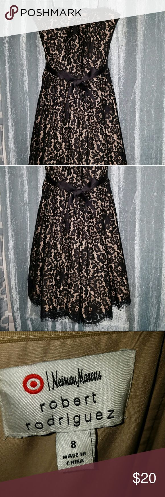 Neiman Marcus black lace dress! Black lace dress with black tie around waist.  Dress is strapless but does have bra straps on each side to help hold up the dress...zippered located in the back of the dress.  Excellent condition! Neiman Marcus Dresses