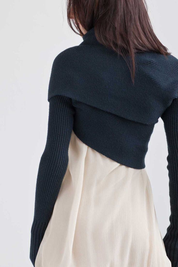 I have this sleeve shrug in slate & black. I love it. New Form Perspective