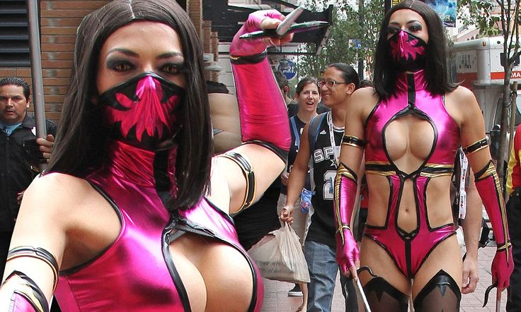 It wouldn't be Comic-Con without her! Adrianne Curry once again ignites every geek's fire in a barely there Mortal Kombat costume #Geek