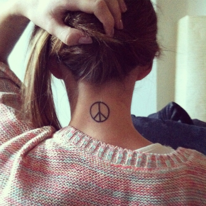Peace Tattoo - I'd like to get one here also.  Who knows...........