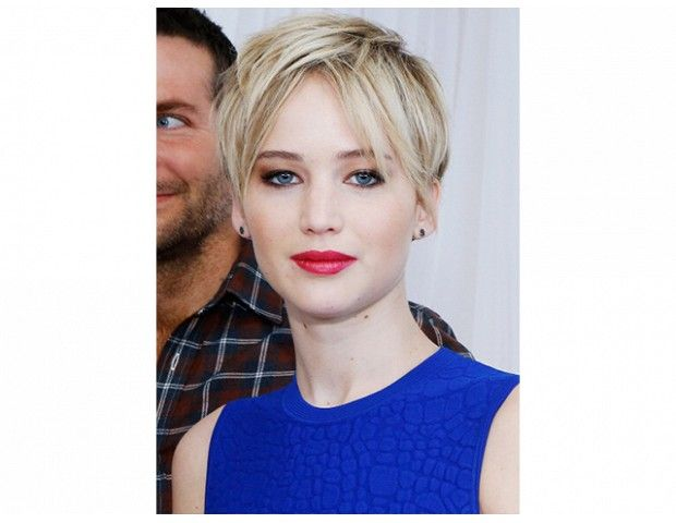 @Byrdie Beauty - Bleached Pixie    We love the cool undertones of this bleach blond color and the face-framing layers.