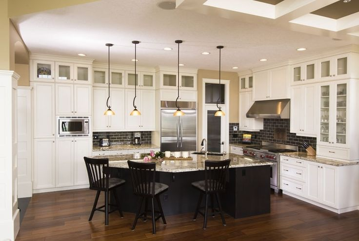 Sharp Contrast The White Cabinets And The Dark Centre Island In This Kitchen Illustrate The
