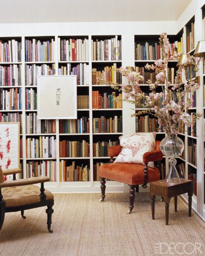 Love this Vintage Collector look.  Hang pictures on bookcases to add depth and interest.  It breaks up a significant number of books.