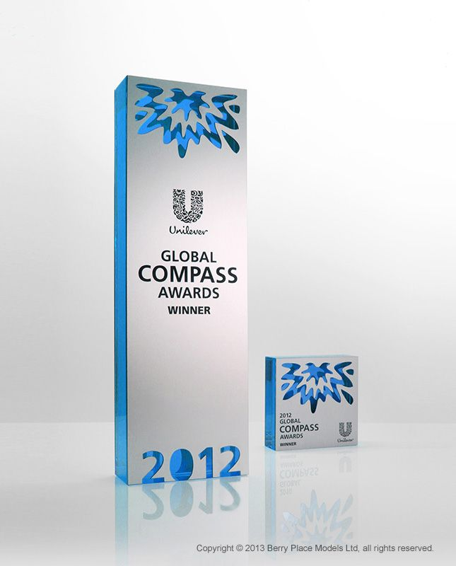 Compass Award: Custom cast blue acrylic faced with laser engraved anodised aluminium. Berry Place