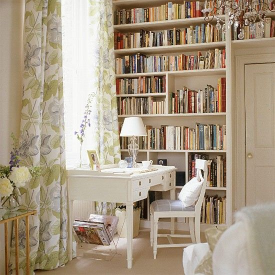 Need somewhere to store all your books? This floor-to-ceiling shelving is a feature in its own right, while extending it over the top of the door is a great decorating idea that makes use of otherwise wasted space