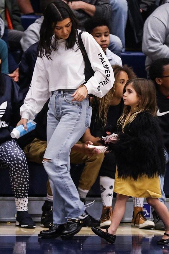 3f06148a77d Kourtney Kardashian wearing Miss Sixty X Palmer Girls Crop Tee ...