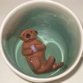 Sea Otter Surprise Mug by SpademanPottery on Etsy, $25.00. i had something like this when i was little and loved it. must buy for H!