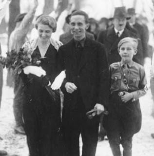 Nazi newlyweds.  Joseph Goebbels and new bride Magda on their wedding day, 19 December 1931.  With them is Harald Quandt, Magda's son from her first marriage.  Harald would be the only member of the family to survive the fall of Germany.