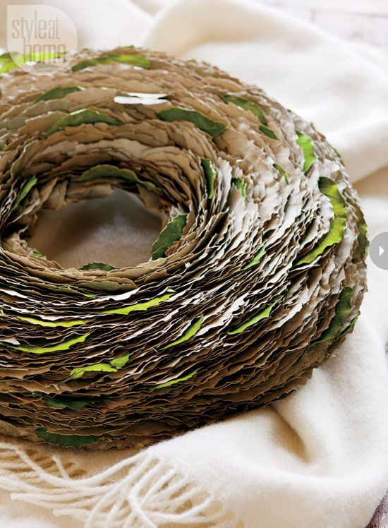 Wreaths - Style At Home A new take on a traditional wreath, this one uses hundreds of dried leaves – punctuated with a few fresh green ones – for a tissue paper-like effect and is laid down, rather than hung, for a casual vignette