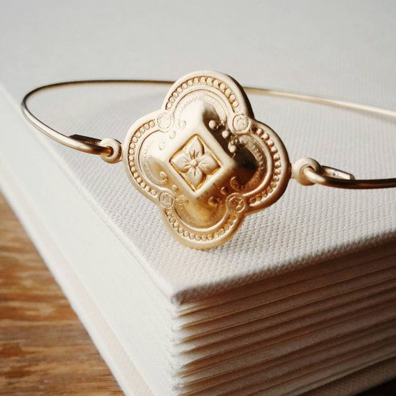 Brass Gold Medallion Bangle on Etsy https://www.etsy.com/ca/listing/243992022/gold-medallion-charm-stackable-bracelet