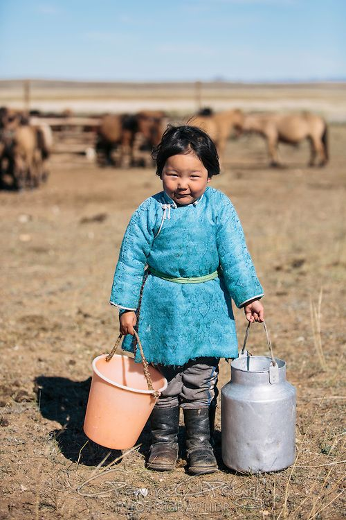 A Mongolian girl carrying milk in buckets, The Mongolian Steppe, Dashinchilen, Mongolia