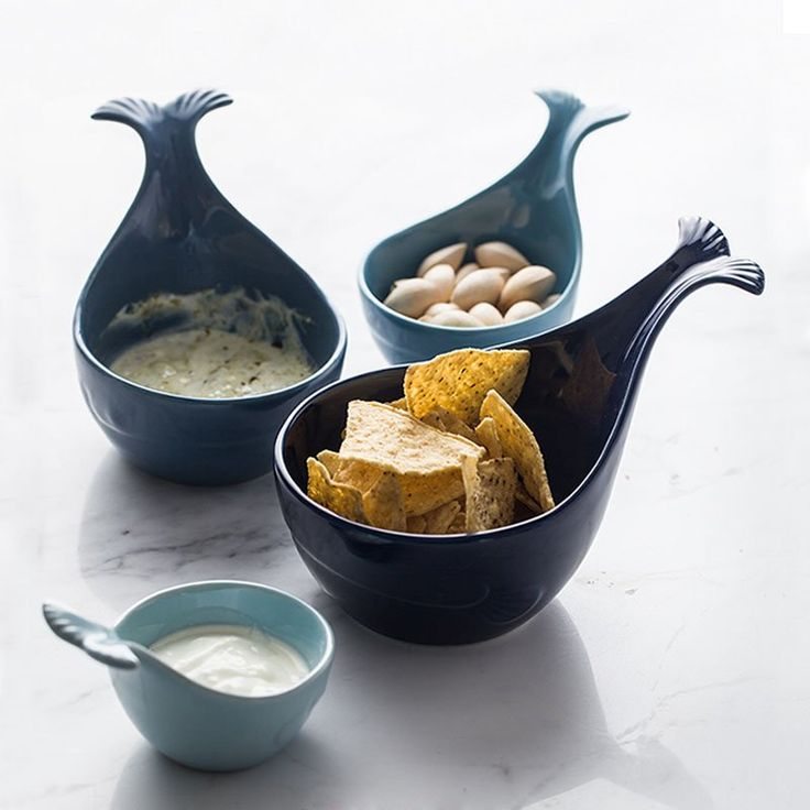 Whale Tale Ceramic Serving Bowls  This wayfaring whale welcomes culinary cargo, think snacks like popcorn and chips or even a small salad.   Durable, cheerful and easy to transport snacks. Perfect for parties or kids. Bowl is perfect for snacks, popcorn and chips Great for party or kids Nice house warming gift Unique and fun design