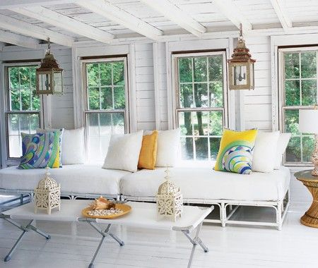 Chic Cottage Living Room    Carved lanterns, Pucci-style printed pillows and seashells add pattern and texture to an all-white space.      Painted bamboo & white terrycloth upholstery is easy to clean & swimsuit-friendly. - Designer: Michelle Lloyd Bermann, Lloyd Ralphs Design --  Modern Cottages | House & Home, July 2007