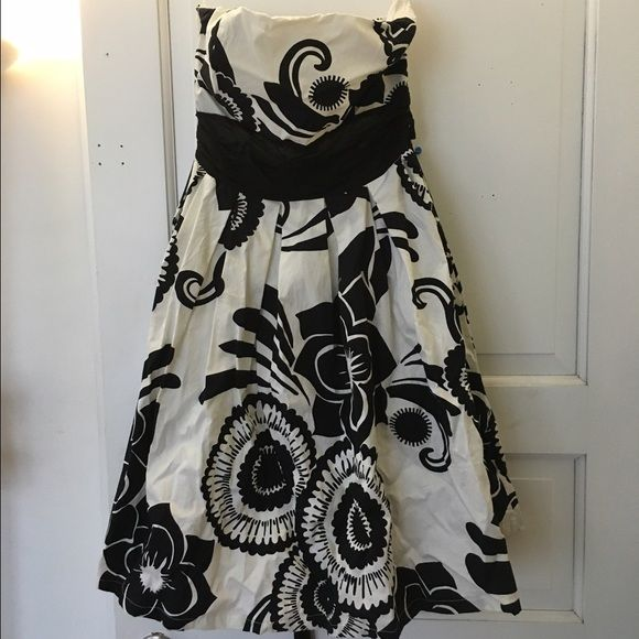 """Summer sun dress Worn only once to a wedding. Strapless dress with a ribbon to tie below the bust. Black and white design. Cotton material. Another lining underneath. Falls at the knee and I'm 5'3"""". Size small Dresses"""