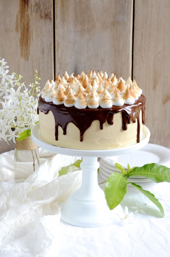 The ultimate layered S'mores chocolate cake with mascarpone caramel frosting, dark glossy chocolate chocolate ganache and dainty meringue peaks.