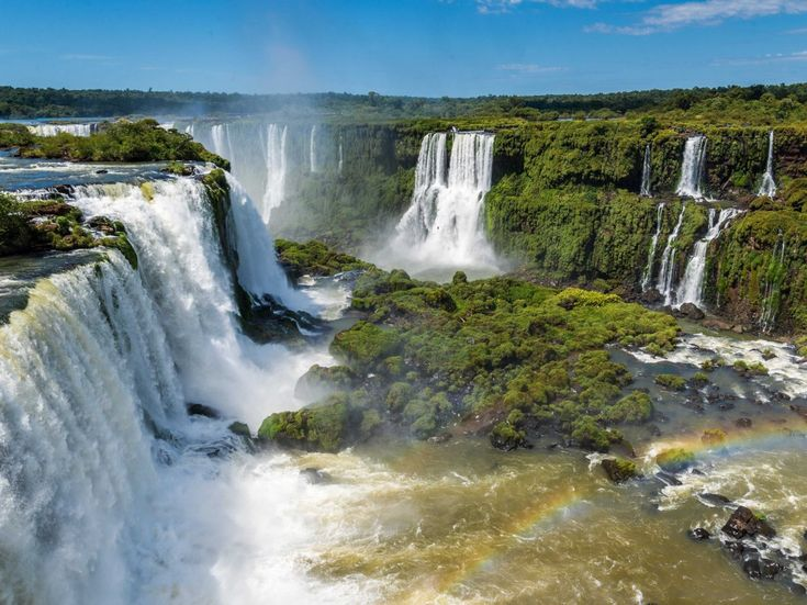 The Iguazu National Park, located on the northeastern tip of Argentina and bordering the Brazilian state of Parana, hosts a semicircular waterfall that actually forms the border between the two countries and has a diameter of almost 984 feet (300 meters).  Read more: http://www.businessinsider.com/unesco-natural-wonders-around-the-world-2015-6?op=1#ixzz3fGnxiqz8