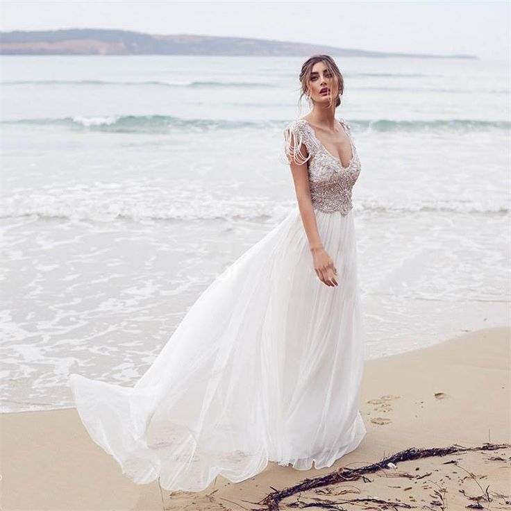 http://fashiongarments.biz/products/2017-vestido-de-noiva-sexy-deep-v-neck-chiffon-beach-wedding-dress-cap-sleeves-backless-crystal-beaded-wedding-gowns-for-bride/,   		Welcome To Our Store	 		About Us	 		Welcome every sincere customer who inquires or purchase our dresses! We sell our dresses at low price because we have our own factory. 	 		We make it for you at an incredible price. please ask for details. We have a very large collection of Wedding, Bridesmaid and Evening/Prom dresses! 		It…