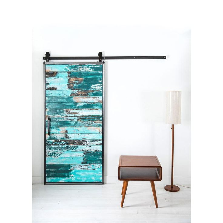 This modern aqua wood barn door is practically a moving piece of art. Built from steel frames and solid alder slats, it's made to last. This is one of The Home Depot most pinned products.