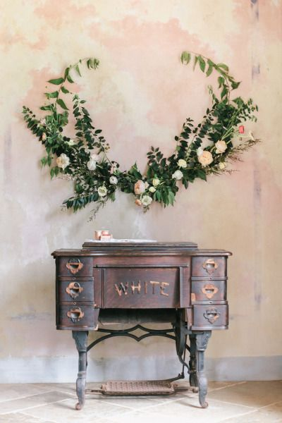 Rose and eucalyptus spray + antique sewing table.   Photography: Exquisitrie By Kelly Sauer - www.exquisitrie.com/