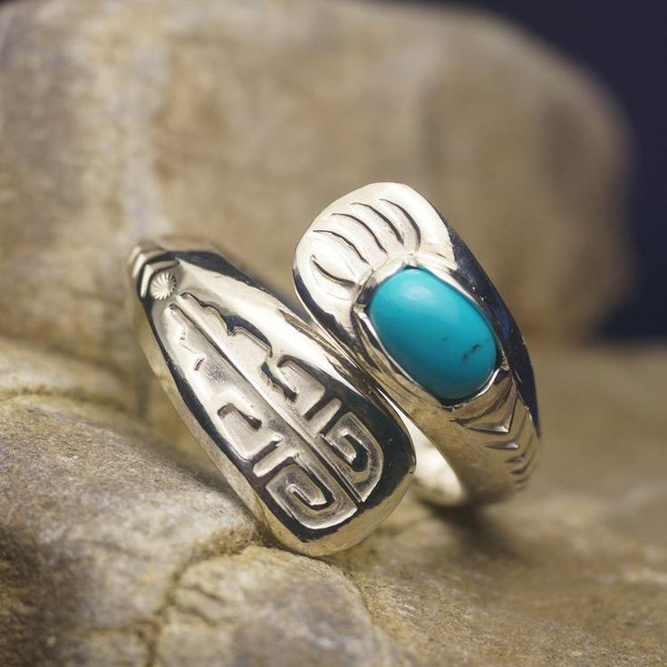 A silver wrap-style, adjustable ring inspired by Hopi Indian art.   One end of the ring features a turquoise gemstone, the other an engraved pattern.   #handmade  #tribal  #ring