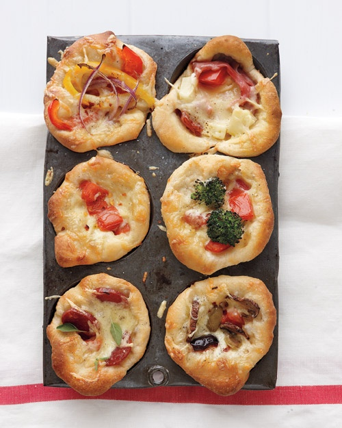 """A muffin tin becomes a kid-size pizza pan -- just tuck in rounds of homemade or store-bought pizza dough and pile on your choice of toppings. Let everyone make their own pizzas for family game night or slumber parties."""