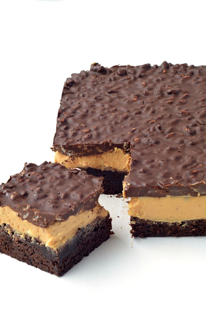 Peanut Butter Chocolate Brownie Crunch Bars with a cocoa brownie base, a creamy peanut butter filling and a crispy chocolate topping made with Rice Bubbles.