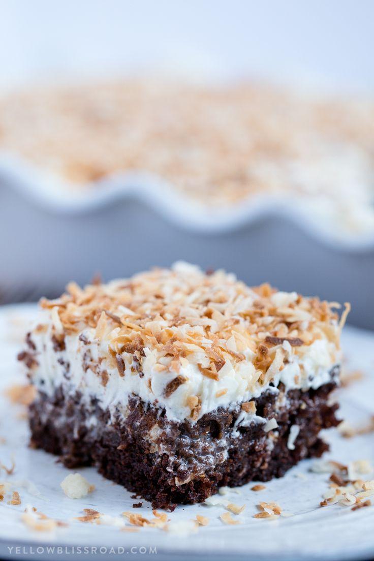 Chocolate Coconut Cream Poke Cake - Rich chocolate cake, coconut cream filling and fluffy, creamy frosting. A rich and decadent dessert! via @yellowblissroad