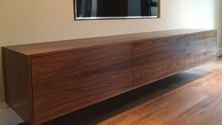 Contemporary walnut wall TV unit. This floating TV unit is handmade in Britain by AV Soul. Each piece of AV furniture is custom made. The perfect fit for every customer.