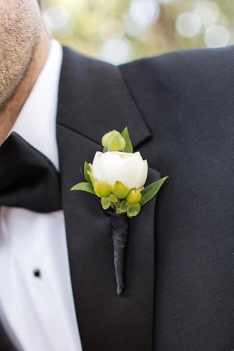 25) close up of groom's boutonierre