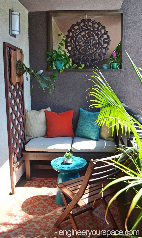 This rental balcony makeover is full of small balcony ideas you can use, especially if you live in a rental apartment, can't make any holes in the walls or are on a budget! I transformed an odd opening into a beautiful custom feature, I built a DIY custom bench which only cost $30 in materials and I came up with a clever way to install a trellis without making any holes in the walls. I also made a table that saves space on a tiny balconies and finally I installed smart outdoor LED lights.