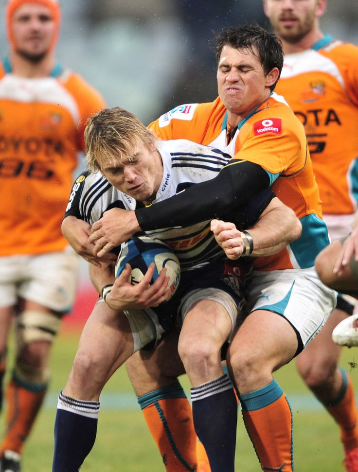 Joe Pietersen of the Stormers and Sias Ebersohn of the Cheetahs in action during the round 17 Super Rugby match between Toyota Cheetahs and DHL Stormers at Free State Stadium on July 7, 2012 in Bloemfontein, South Africa.